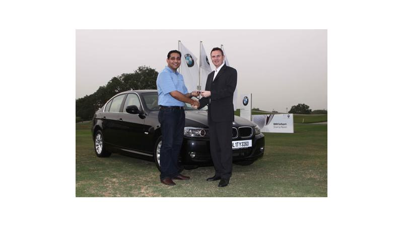 Winner of the BMW Hole-in-One Challenge receives the new BMW 320i