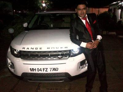 Kapil sharma with his range rover car