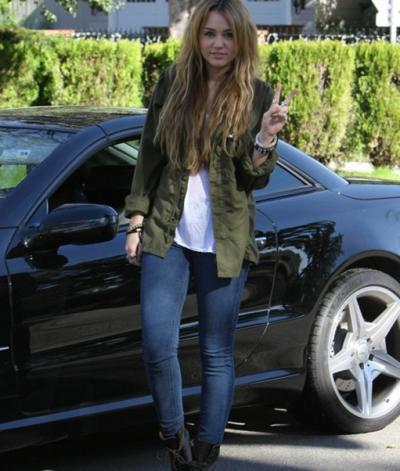 Miley cyrus with her car