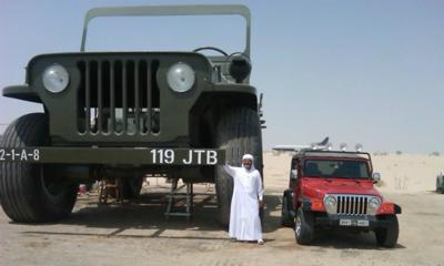 Rainbow sheikh with his cars