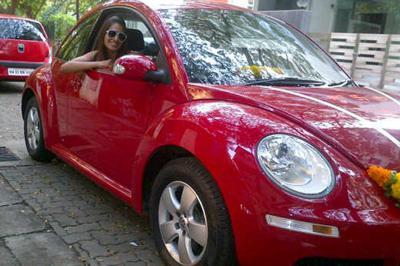 Sensual bipasha proud owner of volkswagen beetle