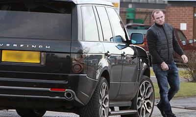 Wayne Rooney with his car