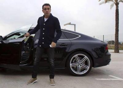 Xavi with his car