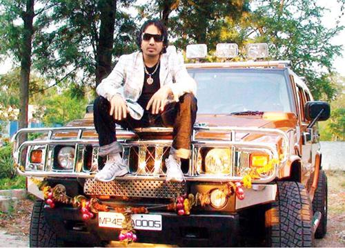 Mika Singh and his orange Hummer