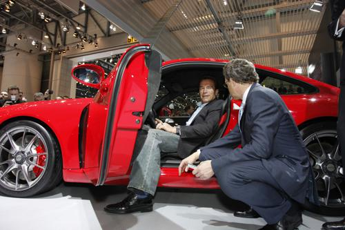 Arnold Schwarzenegger visits the Porsche stand at Geneva Motor Show